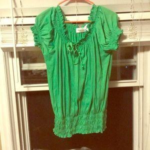 Green ruffled shirt